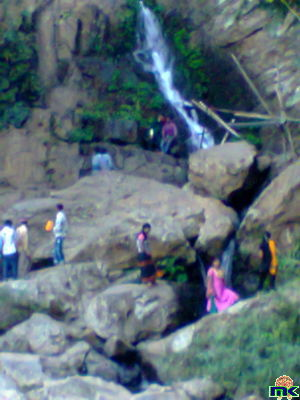 Click to view full size image  ==============  AKASHIGANGA WATERFALL OF AKASHIGANGA, NEAR DABAKA IN NAGAON DISTRICT OF ASSAM. THERE IS A SIVA MANDIR . AKASHIGANGA IS A GOOD PICNIC PLACE. A 'MELA' IS ORGANISED ON THE OCCASION OF 'SIVA RATRI' EVERY YEAR. ONE SHOULD VISIT THE PLACE  & ENJOY.
